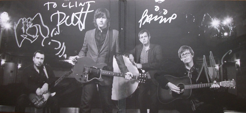 The Old 97's The Grand Theater Vol. 1 cd inside spread autographed by (from left to right) Ken Bethea, Rhett Miller, Philip Peeples and Murray Hammond.