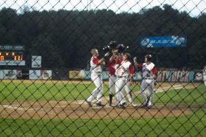 Kris Koerper and teammates celebrate after Koerper's 3-run home run